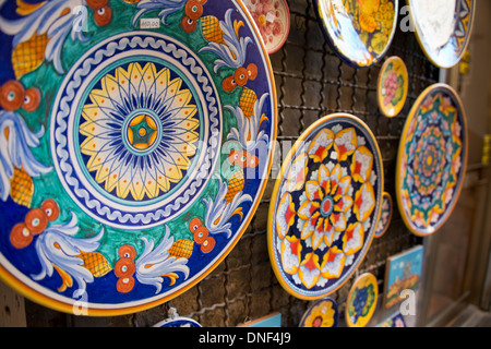 Italy Orvieto. Detail of traditional Italian hand painted pottery plates for sale in the & Colorful display of hand painted plates covers the outside wall of ...