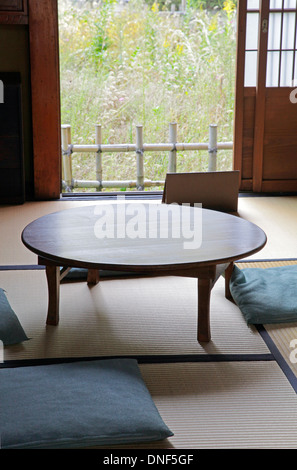 A Chabudai traditional Japanese table in a Tatami mat room at Edo -Tokyo Open Air Architectural Museum - Stock Photo
