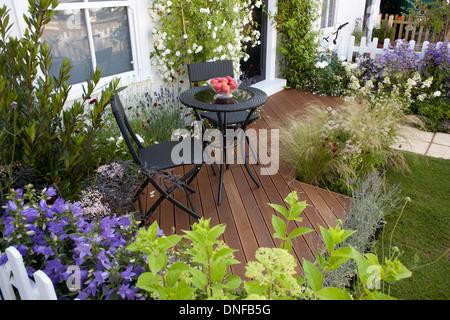 Decked patio in small town garden. - Stock Photo