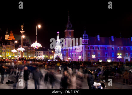 People in motion and christmas illuminations - Stock Photo