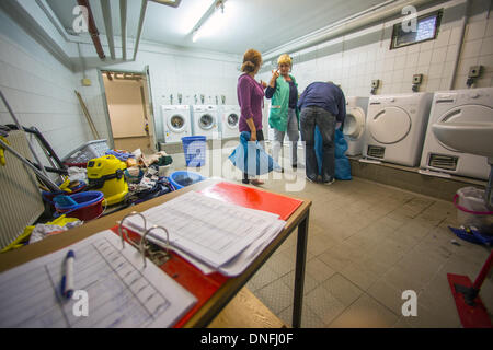 Berlin, Germany. 12th Dec, 2013. Refugees wash their clothes in a refugee home in Berlin, Germany, 12 December 2013. - Stock Photo