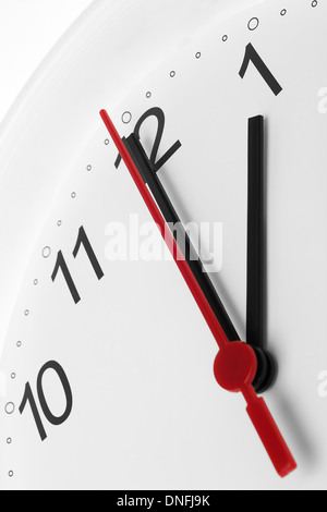 Clock face showing lunch break and working time on white background - Stock Photo