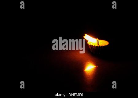 Burning diya at dark wind a concept of 'Hope' - Stock Photo