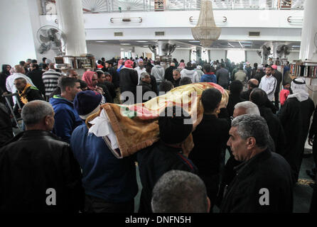 Jerusalem. 26th Dec, 2013. Israeli Bedouins carry the body of Salah Abu Latif during his funeral in the Bedouin - Stock Photo