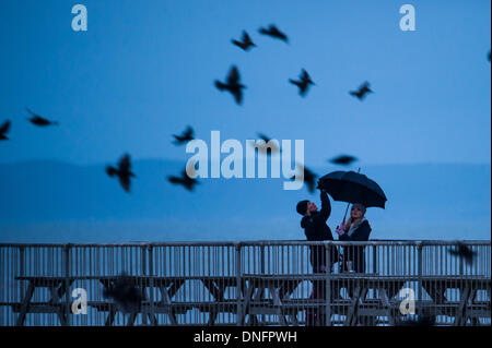 Aberystwyth Wales UK, Boxing Day, 26 December 2013 Two women, mother and daughter, take shelter under an umbrella - Stock Photo