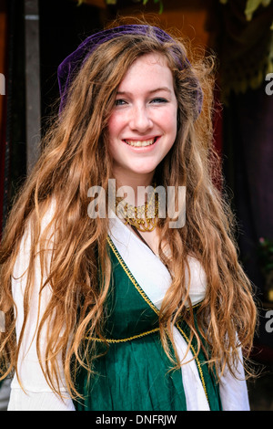 Young teenage girl dressed in medieval clothes at a fair in Sarasota FL - Stock Photo