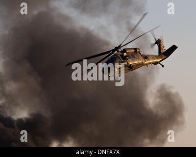 Hazerim, Israel. 26th Dec, 2013. Israel Air Force Blackhawk helicopter rescue crew demonstrate airlift rescue at - Stock Photo