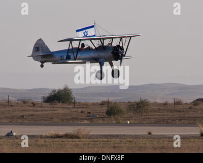 Hazerim, Israel. 26th Dec, 2013. Israel Air Force historical Stearman aircraft takes off flying the Israeli flag - Stock Photo