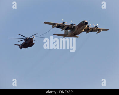 Hazerim, Israel. 26th Dec, 2013. Israel Air Force Hercules C130 performs aerial refueling of a Sikorsky CH-53 Sea - Stock Photo