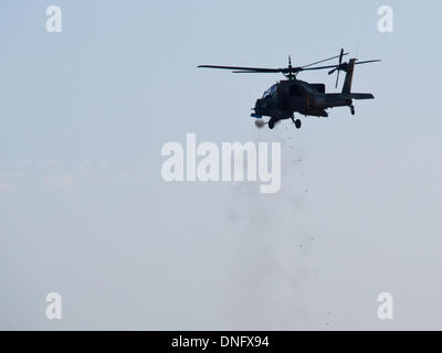 Hazerim, Israel. 26th Dec, 2013. Israel Air Force Apache helicopter fires its cannon at a ground target at an IAF - Stock Photo