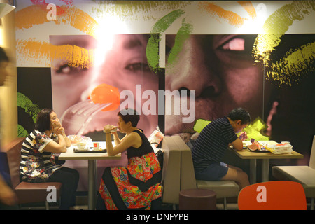 Hong Kong China Island Fortress Hill King's Road McDonald's fast food restaurant inside interior dining area tables - Stock Photo