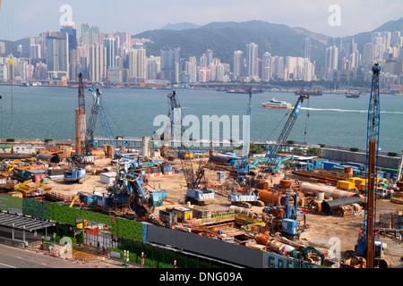 Hong Kong China Kowloon Tsim Sha Tsui New World Centre center construction site cranes economic development Victoria - Stock Photo