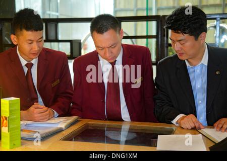 Beijing China Guang An Men Nei Da Jie Guanganmen Outer Street Beijing Hilton DoubleTree hotel lobby bellman valet - Stock Photo