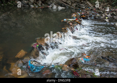 Environmental pollution in the Himalayas. Garbage in the water of Bagmati river. - Stock Photo
