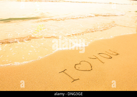 I love you - inscription on the beach sand, soft surf wave. - Stock Photo