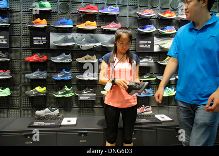 Beijing China Chaoyang District Sanlitun Village South North Piazza Deck shopping mall center centre Nike Store - Stock Photo