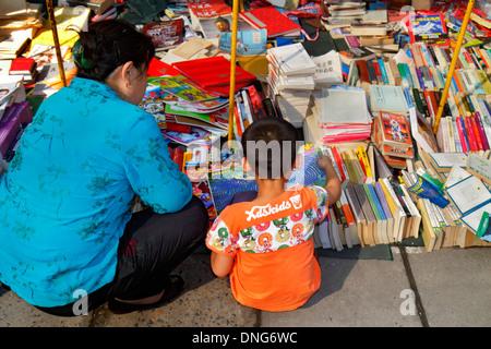 Beijing China Chaoyang District Panjiayuan Weekend Dirt Flea Market shopping selling buying display sale vendor - Stock Photo