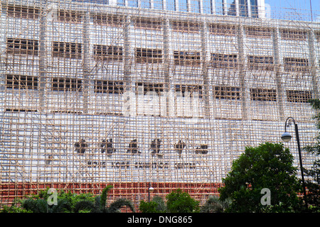 Hong Kong China Island Wan Chai Hong Kong Exhibition Centre center scaffolding bamboo construction renovation parking - Stock Photo