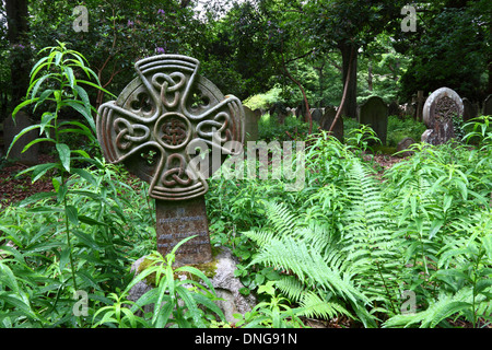 Grave from Celtic Revival period with Celtic knots on cross in St Peters church churchyard , Southborough Common, - Stock Photo