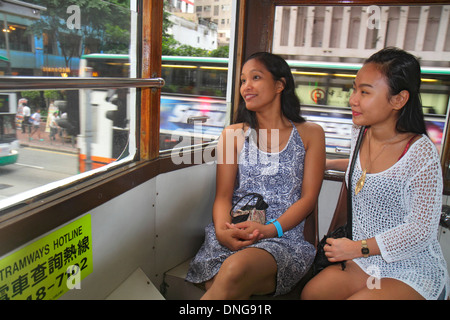 Hong Kong China Island Wan Chai Hennessy Road double decker tram Tramways public transportation inside riders passengers - Stock Photo