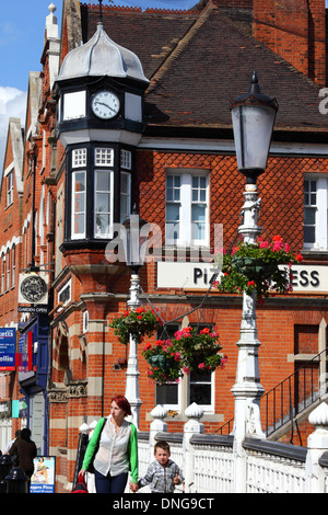 Clock tower on Victorian brick building that houses Pizza Express in High Street, Tonbridge, Kent , England - Stock Photo