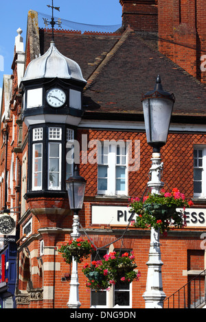 Detail of clock tower on Victorian brick building that houses Pizza Express in High Street, Tonbridge, Kent , England - Stock Photo