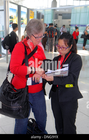 Hong Kong China Chek Lap Kok Hong Kong International Airport HKG Asian woman tourism representative taking survey - Stock Photo