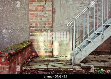 Bottom of a flight of metal stairs - Stock Photo