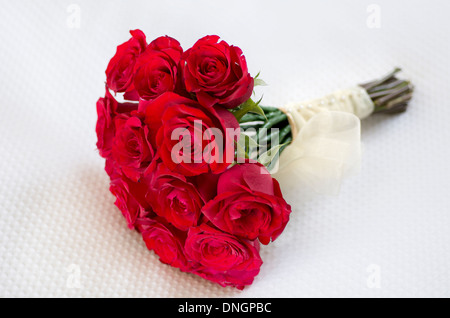 Red roses bridal bouquets Wedding bouquet on white background close up. - Stock Photo