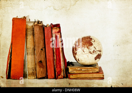 Vintage photo old books and Earth globe - Stock Photo