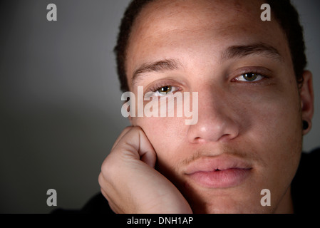 A male teenager and recent graduate. - Stock Photo