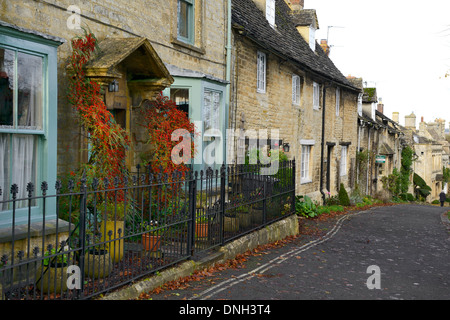 Cotswold cottages and houses along The Hill, Burford, Cotswolds, Oxfordshire, England, United Kingdom, UK, Europe