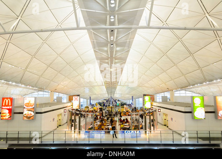 Modern international contemporary airport passenger concourse building ceiling / roof: Hong Kong International Airport. - Stock Photo
