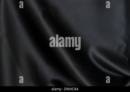 Black Texture - Dark Wavy Glossy Silk Drapery - Stock Photo