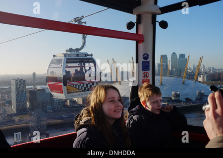 Flying the Emirates  Air Line over the Thames, London UK - Stock Photo