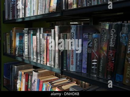 Close up of crime novels books book on library shelf England UK United Kingdom GB Great Britain