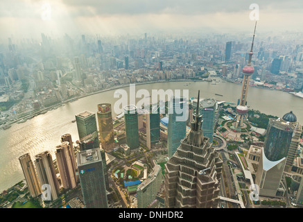 Aerial view Shanghai Skyline, with Oriental Pearl and Pudong skyscrapers, Huangpu River, PRC, People's Republic - Stock Photo