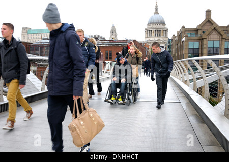 London, England, UK. People crossing the Millennium Bridge over the Thames, between St Paul's and the South Bank - Stock Photo
