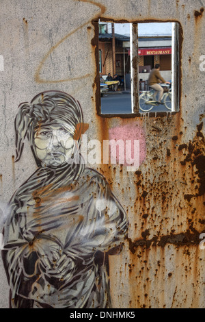 MAN IN A DJELLABA AND TURBAN, GRAFFITI ON THE DOOR OF THE OLD SLAUGHTERHOUSES, CASABLANCA, MOROCCO, AFRICA - Stock Photo