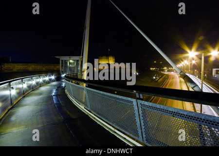 Carlisle Castle at night from the millennium bridge over the Castle way dual carriageway - Stock Photo