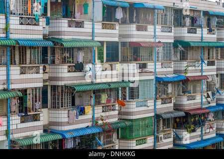 YANGON, MYANMAR - CIRCA DECEMBER 2013: View of the facade of a typical apartment building in the city of Yangon. - Stock Photo