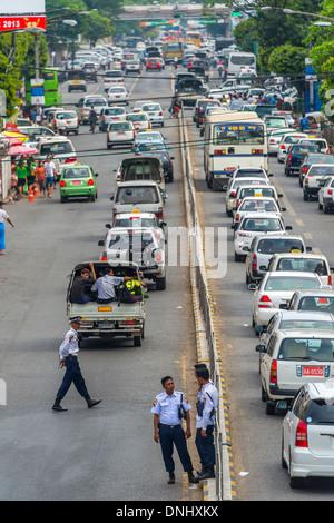 YANGON, MYANMAR - CIRCA DECEMBER 2013: View of the street Bo Gyoke Aung San Rd in Downtown Yangon - Stock Photo