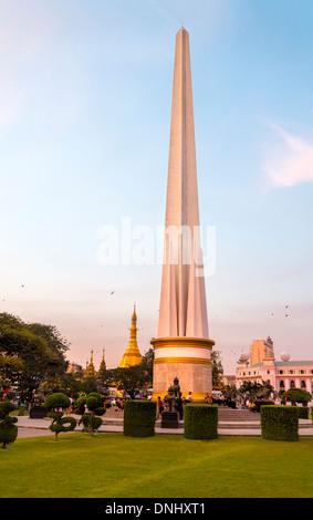 YANGON, MYANMAR - CIRCA DECEMBER 2013: View The Independence Monument in the Maha Bandoola Garden in Yangon. - Stock Photo
