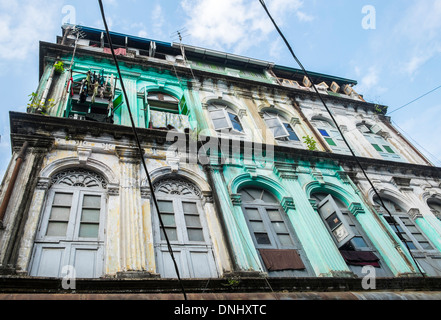 YANGON, MYANMAR - CIRCA DECEMBER 2013: View of typical facade in the streets of Yangon - Stock Photo
