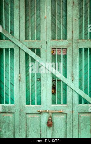 YANGON, MYANMAR - CIRCA DECEMBER 2013: View of a typical door in the streets of Yangon - Stock Photo