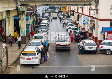 YANGON, MYANMAR - CIRCA DECEMBER 2013: View of lateral street of the BoGyoke Aung San Market in Yangon. - Stock Photo
