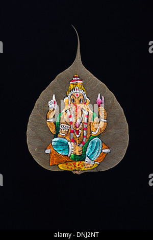 Hand Painted Indian Ganesha design on a Sacred Fig tree leaf / Bodhi tree leaf on black background - Stock Photo