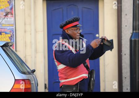Civil Enforcement Officer taking photograph 2011 - Stock Photo