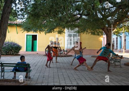 CHILDREN PLAYING SOCCER ON A SQUARE, STREET AMBIANCE, TRINIDAD, LISTED AS A WORLD HERITAGE SITE BY UNESCO, CUBA, - Stock Photo