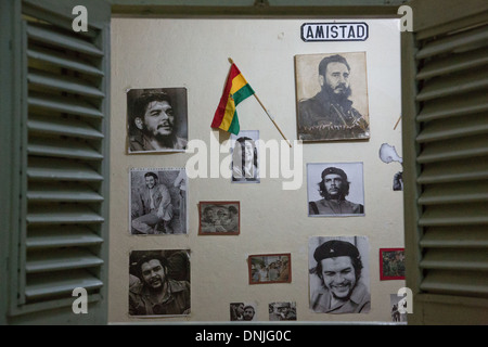 WALL COVERED IN PERIOD PHOTOS OF THE LEADERS OF THE CUBAN REVOLUTION (ERNESTO GUEVARA, CALLED CHE, AND FIDEL CASTRO), - Stock Photo